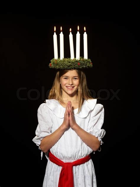 Young danish girl dressed in the traditional Santa Lucia