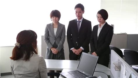 Japanese New Employees Being Told Off By Their Boss In The